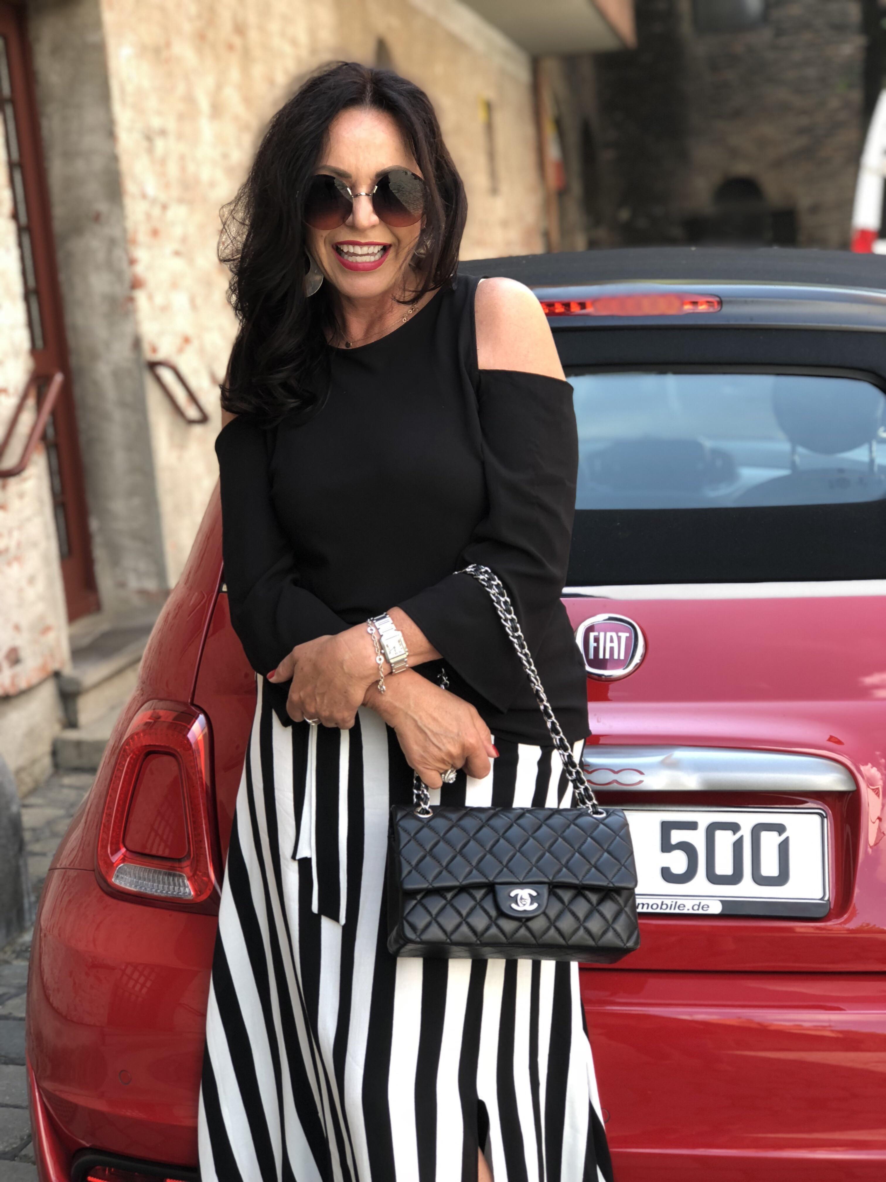 Black and white skirt // red car